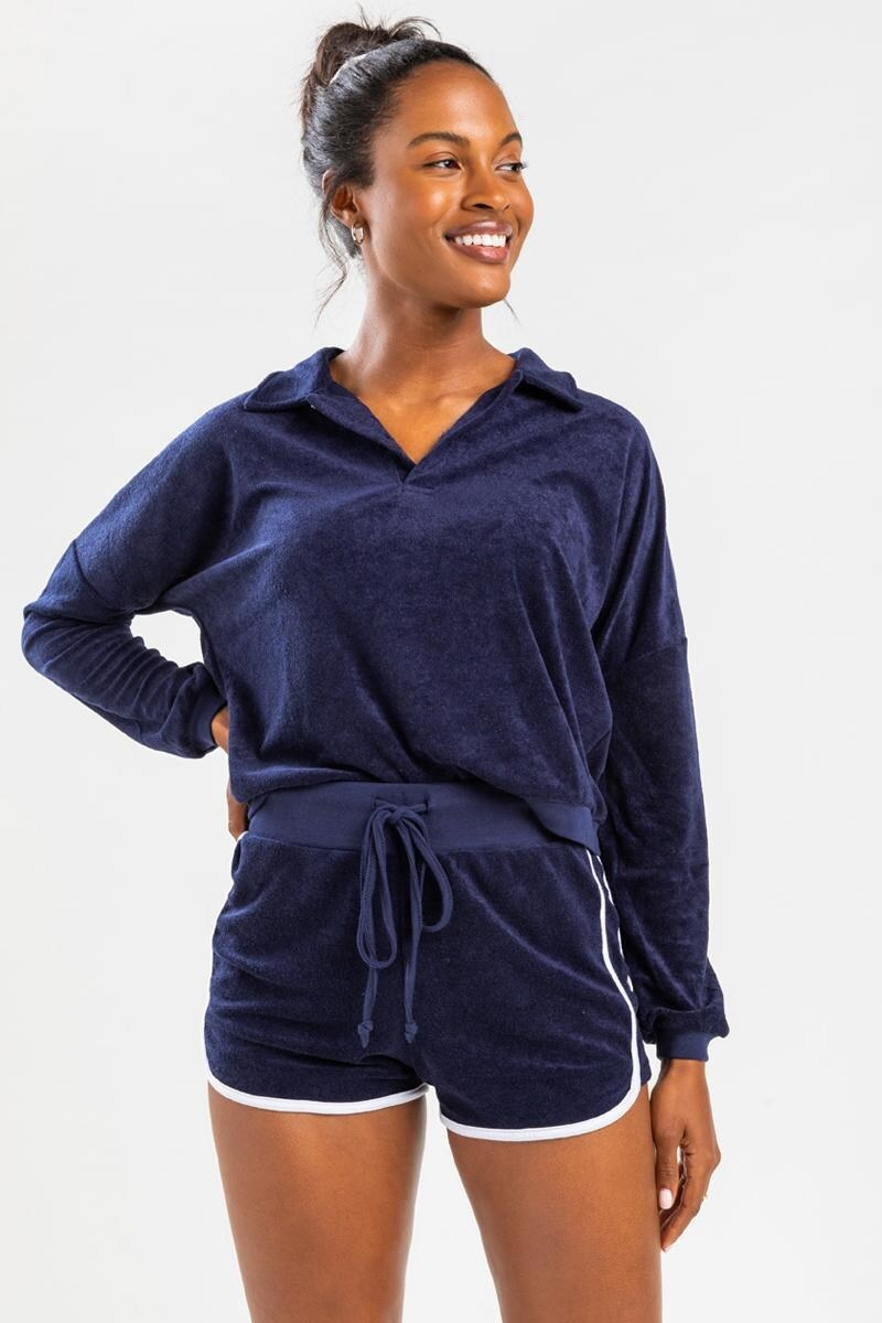 model wearing navy lounge shirts with drawstring and white trim