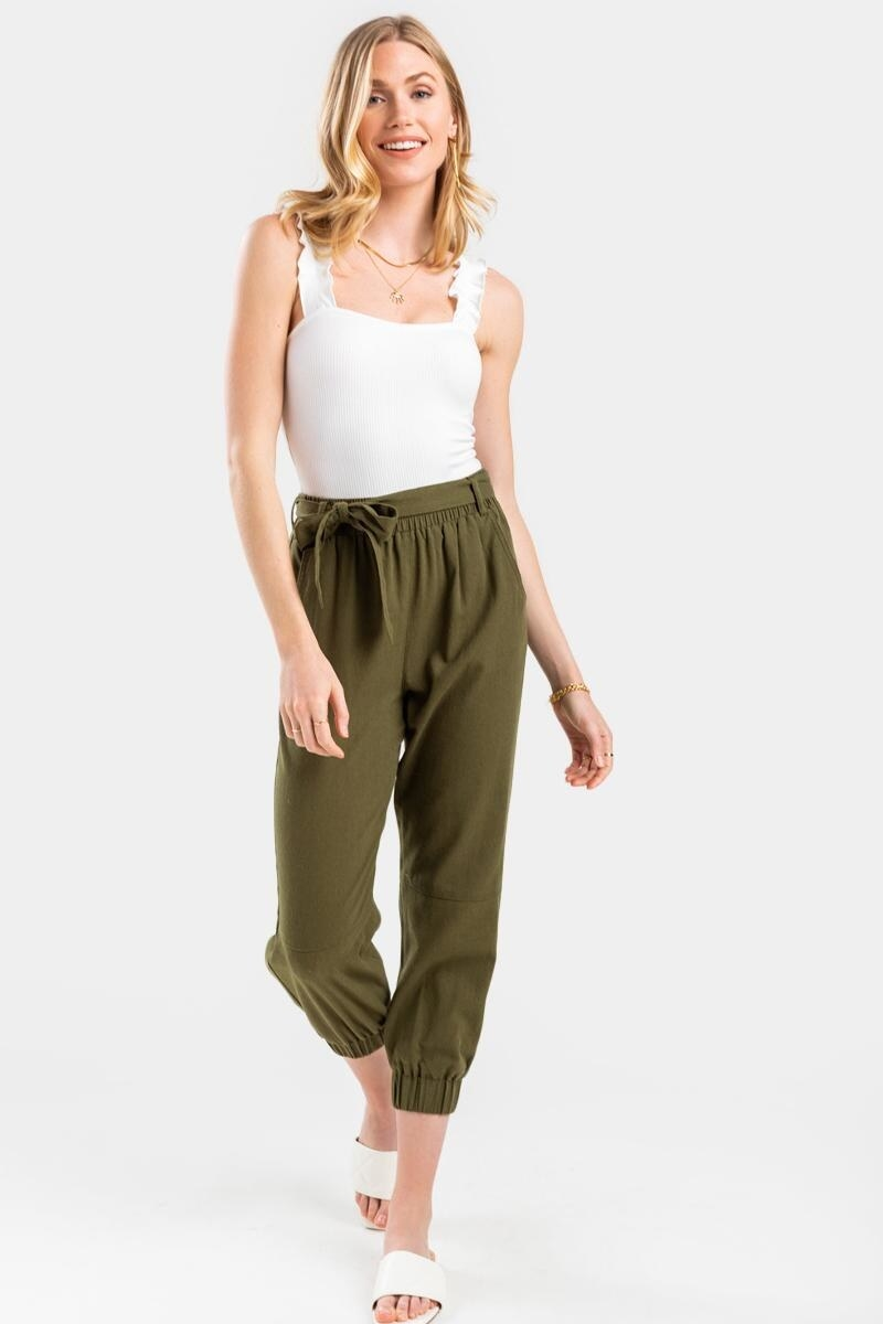model wearing olive green front-tie joggers