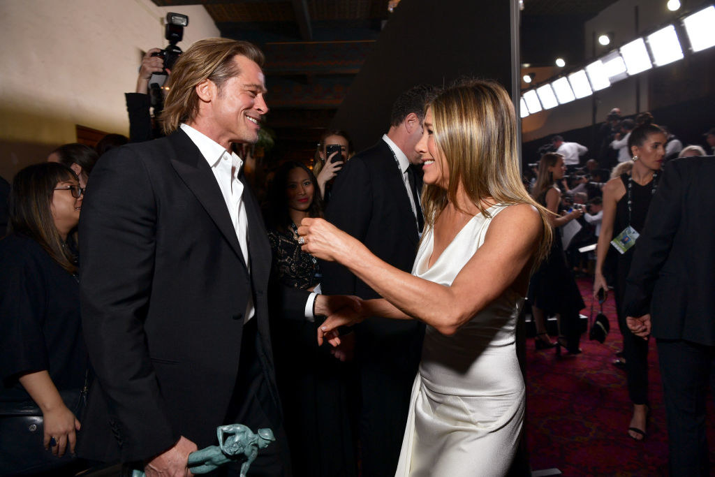 Brad Pitt and Jennifer Aniston reach for each other backstage at the 2020 SAG Awards