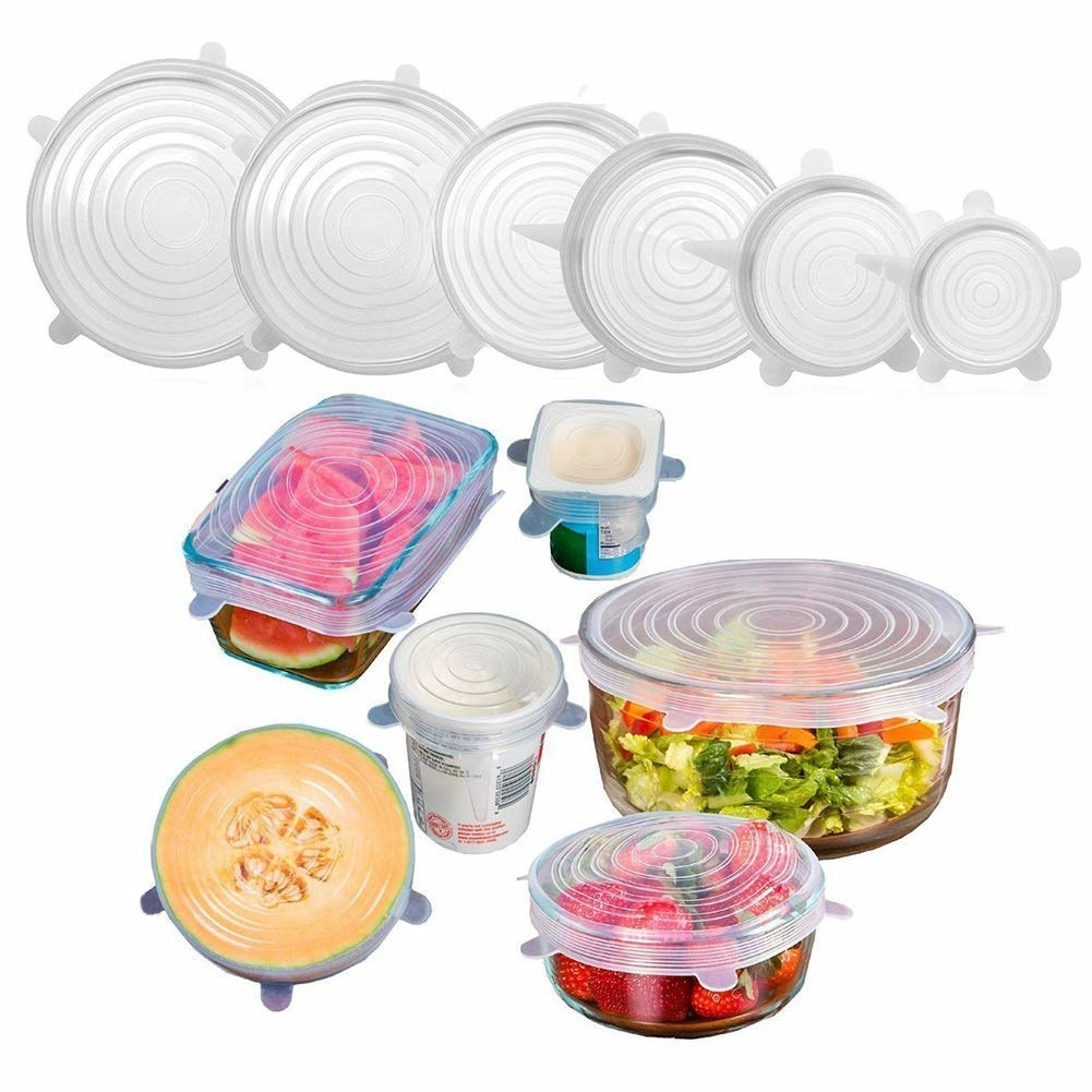 The silicone lids pictured covering bowls, cups and half cut fruits.