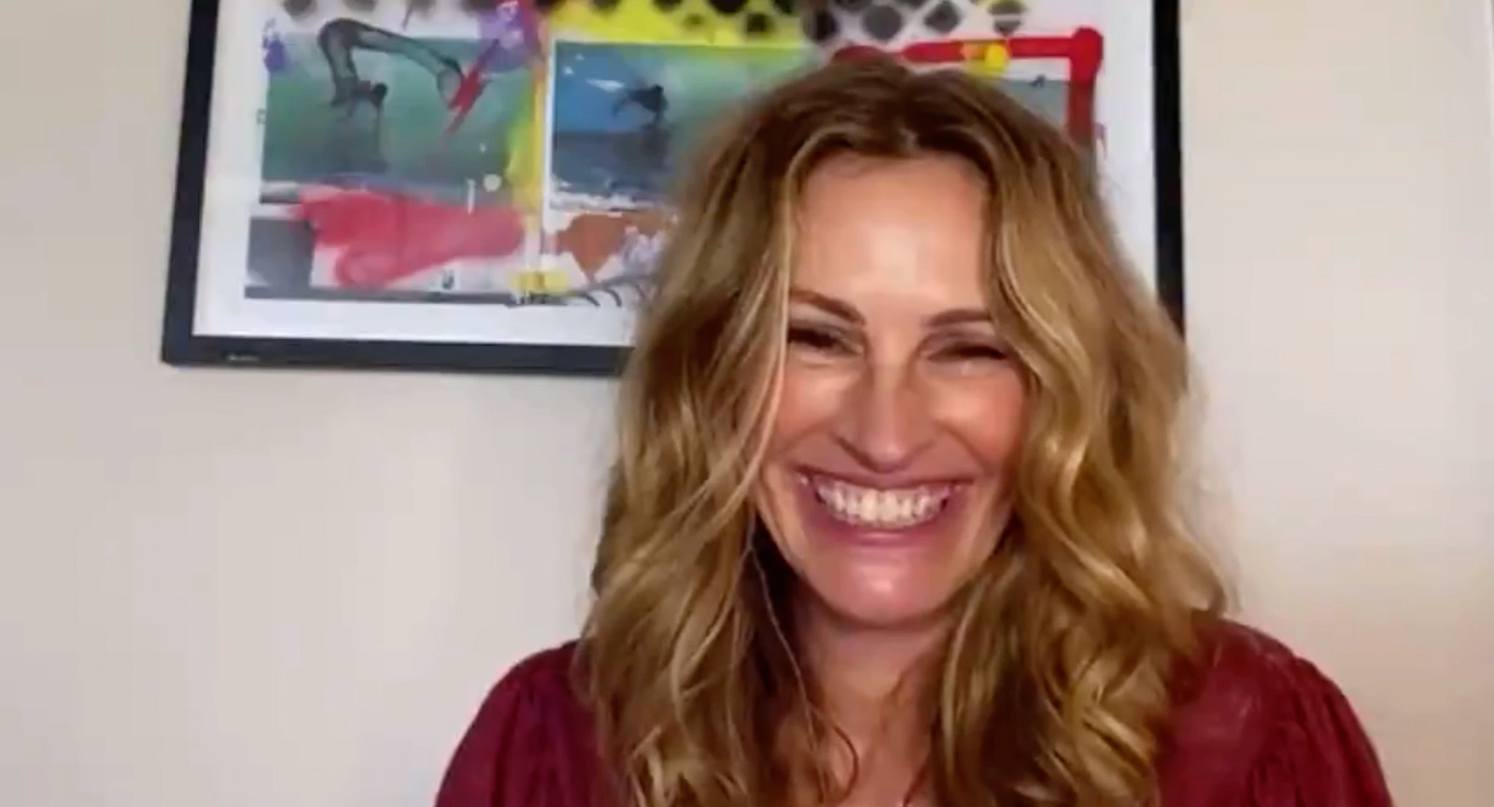 Julia Roberts laughs while watching Brad Pitt and Jennifer Aniston reenact a scene during the table read