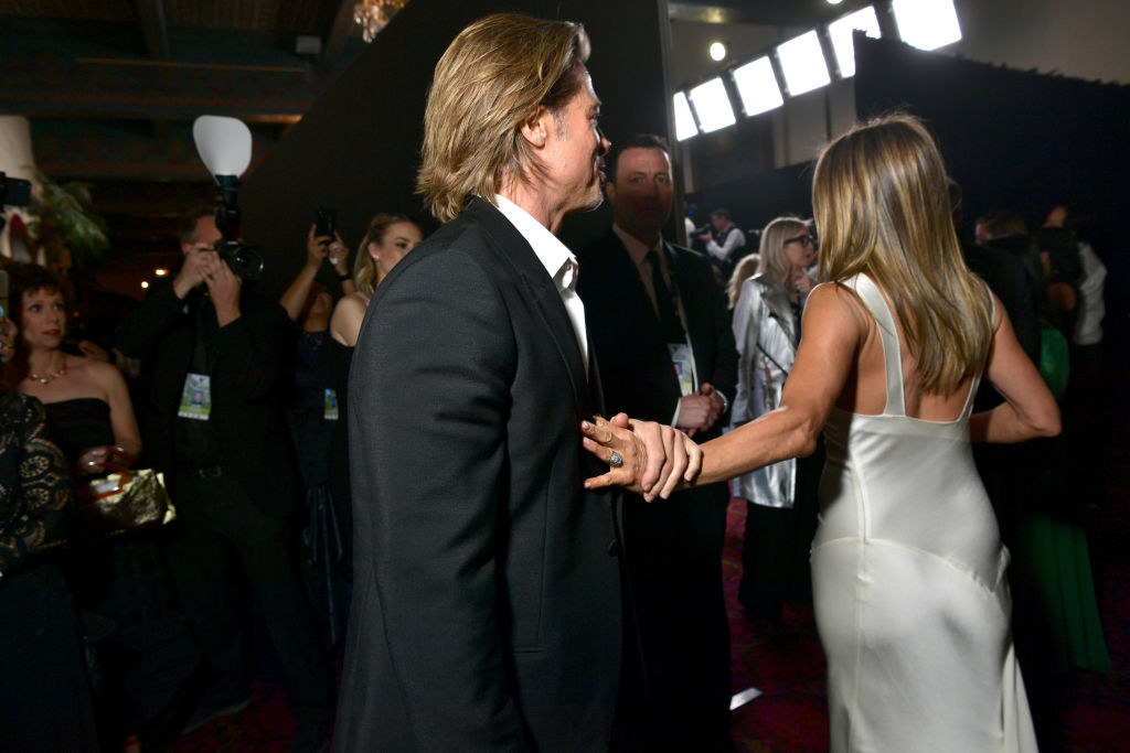 Jennifer Aniston walks away while Brad Pitt holds her hand at the 2020 SAG Awards