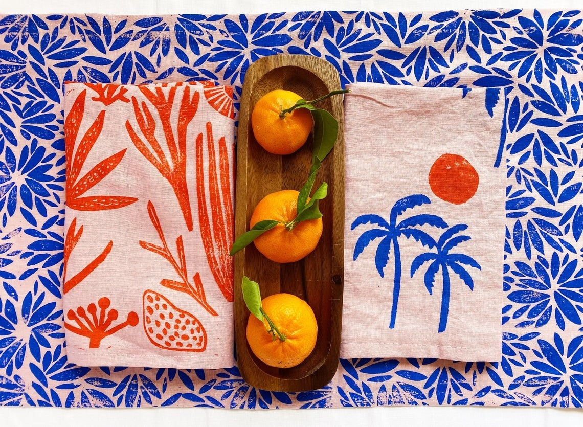 Pink napkins with stamped tropical patterns