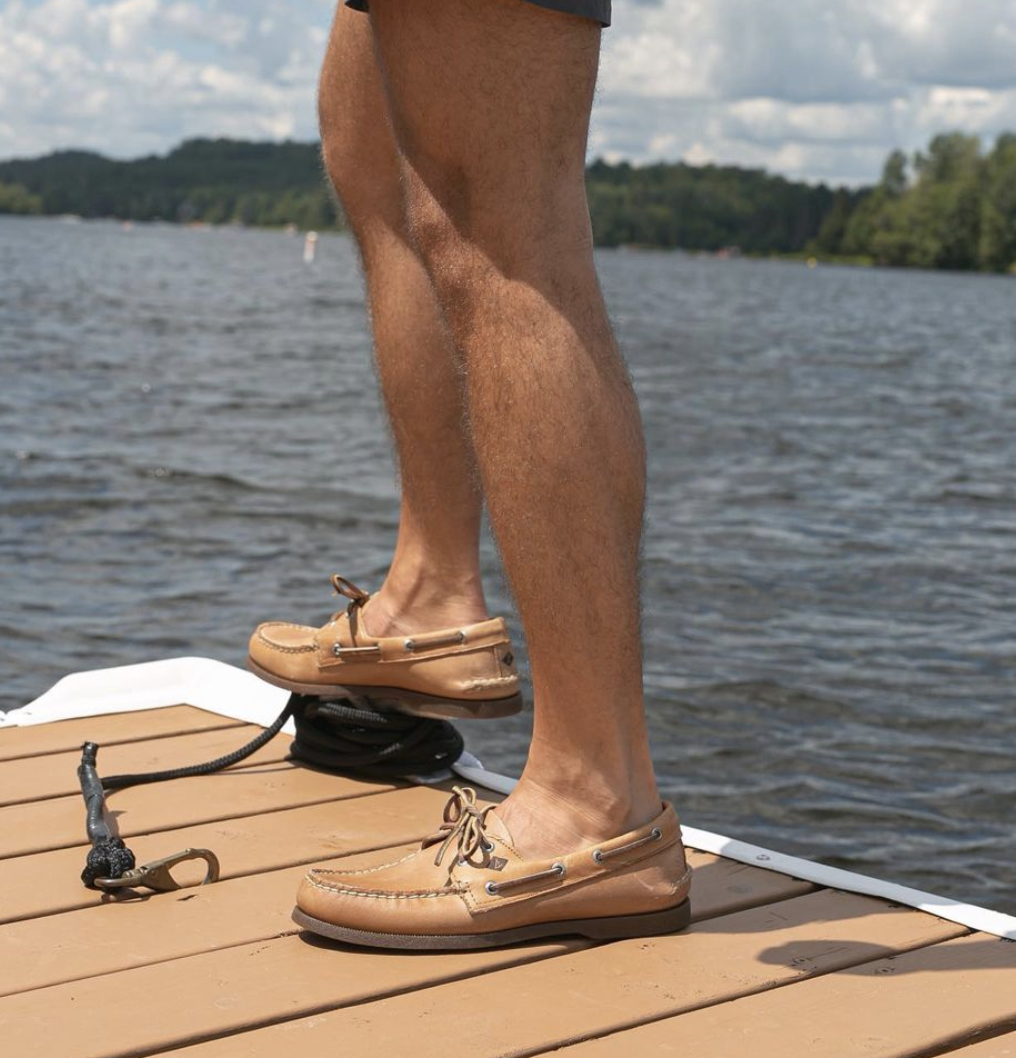 person on a dock with the shoes on