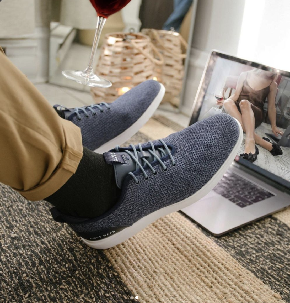 person with his feet up while video chatting