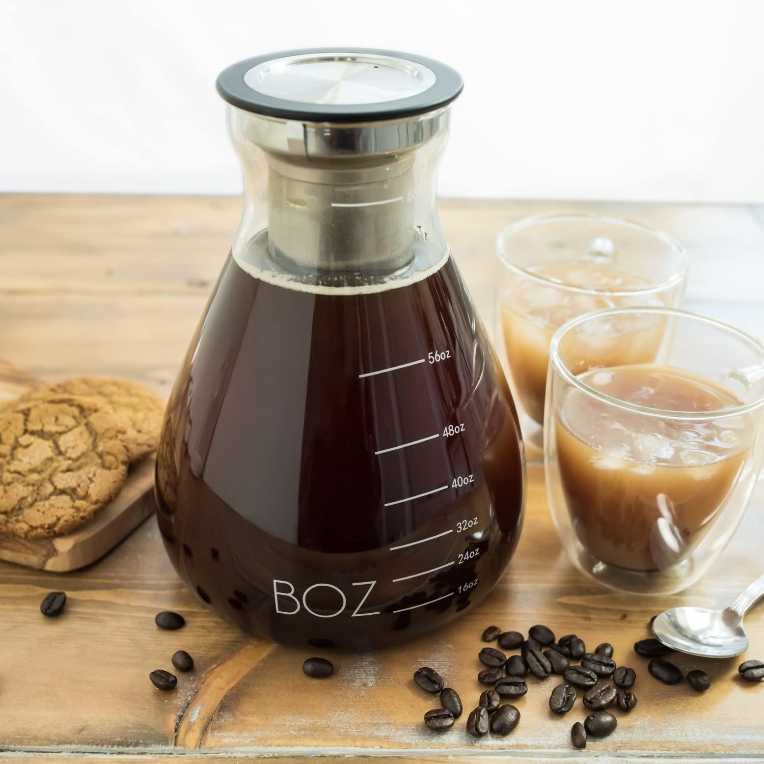 a pitcher of iced coffee on a cutting board