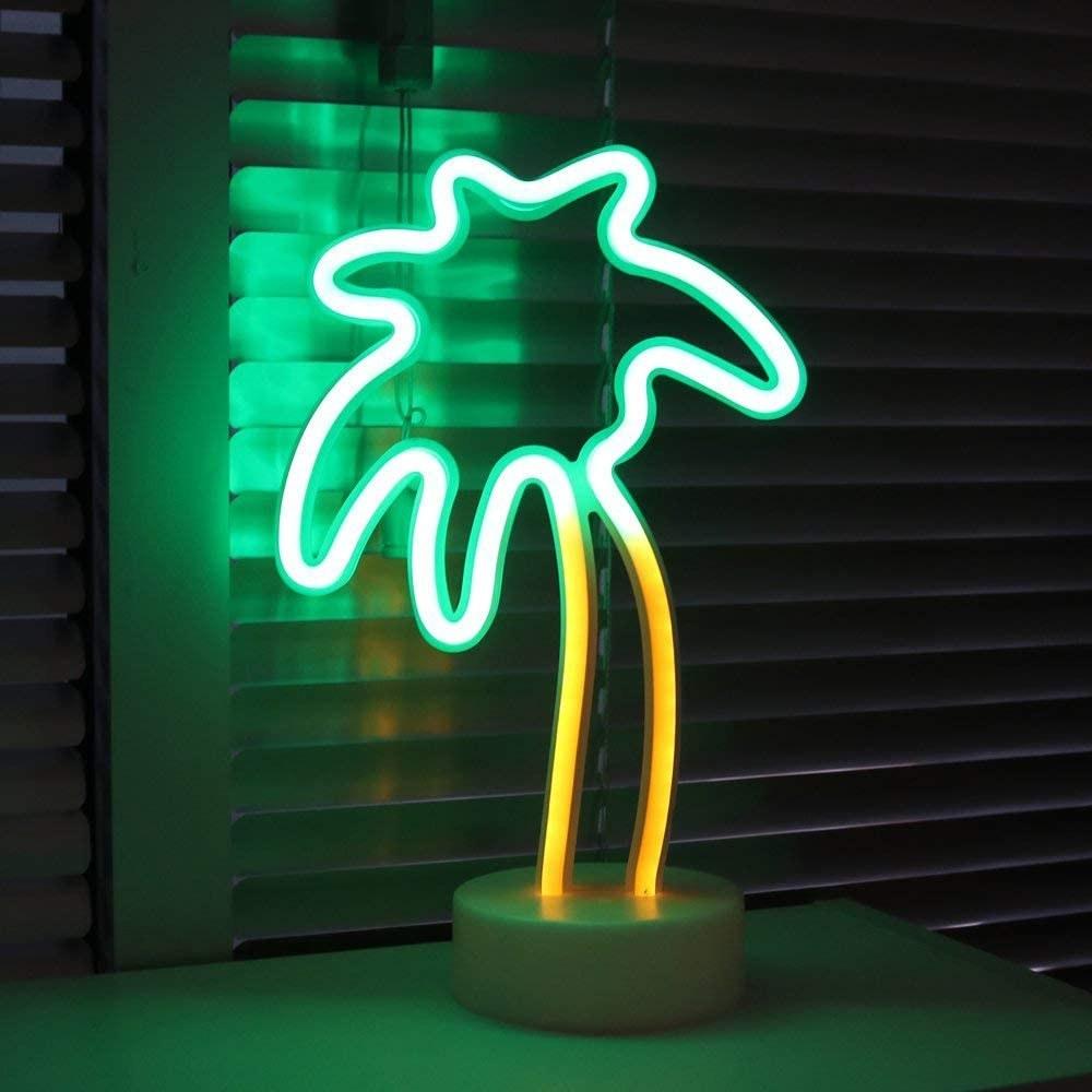 a palm tree shaped neon light
