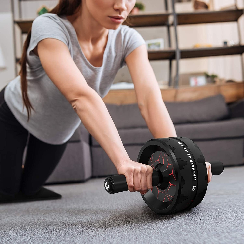 model uses black ab roller on a carpet