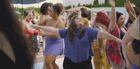 Aidy Bryant dancing at a pool and letting loose