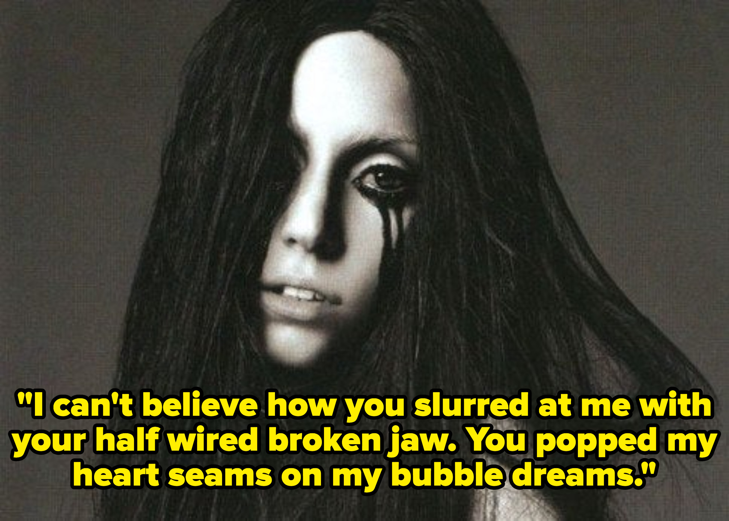 """The Fame Monster album cover with lyrics, """"I can't believe how you slurred at me with your half wired broken jaw. You popped my heart seams on my bubble dreams"""""""