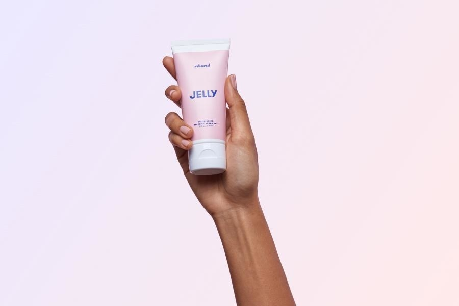 Model holding pink lubricant bottle