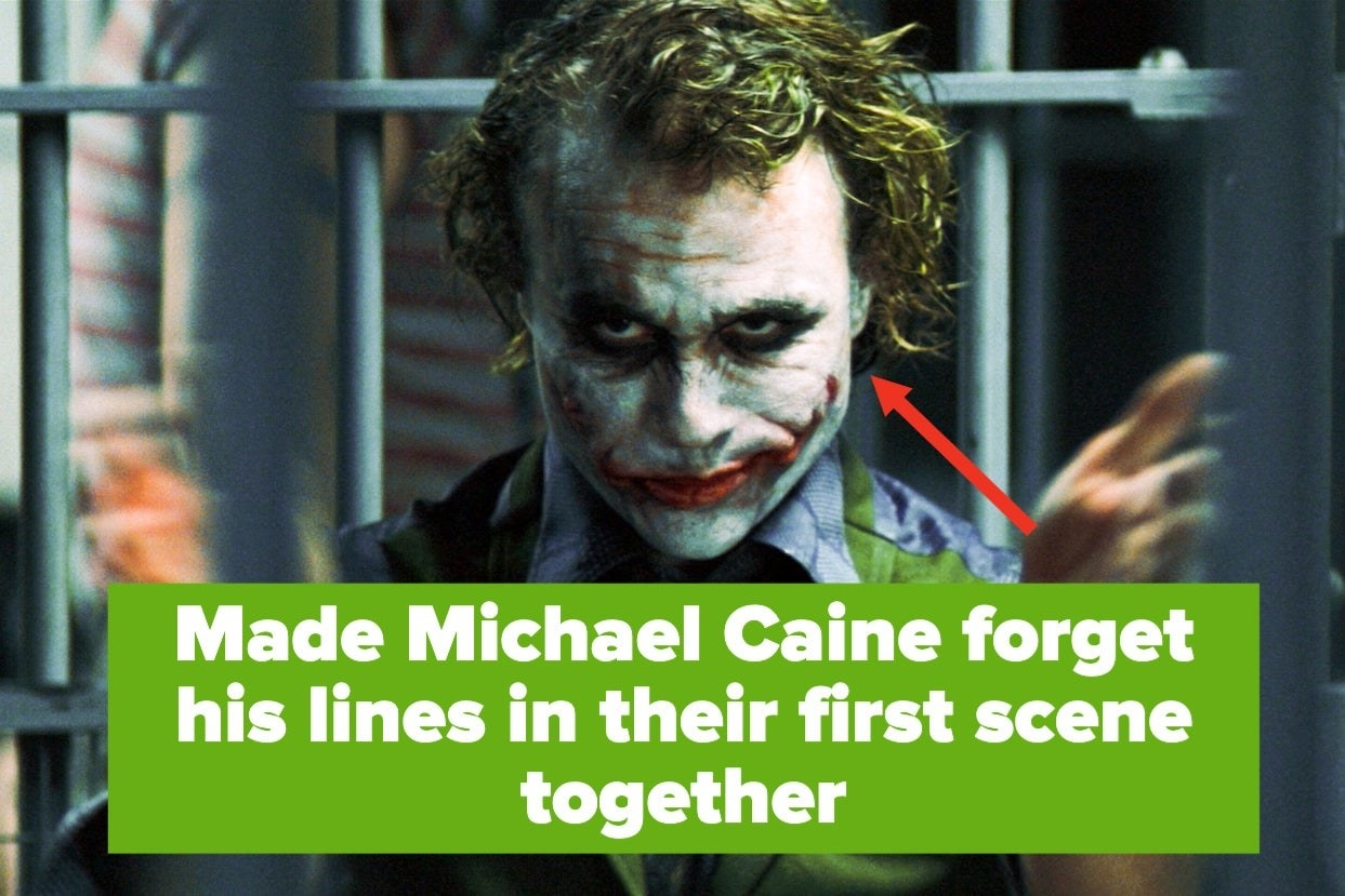 Heath Ledger as the Joker clapping in a jail cell