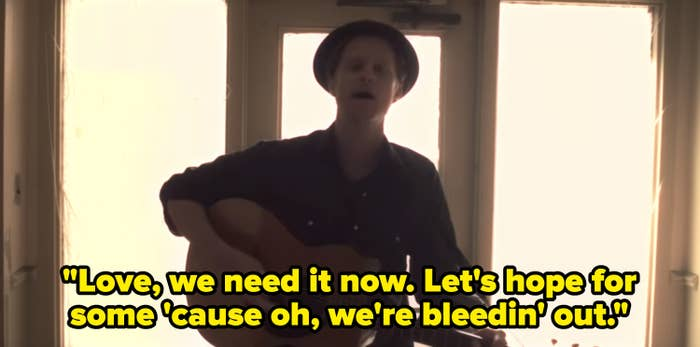 """The """"Ho Hey"""" music video with the lyrics, """"Love, we need it now. Let's hope for some 'cause oh, we're bleedin' out"""""""