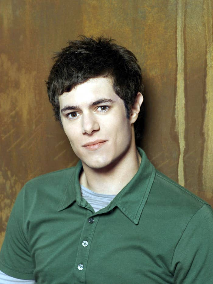 A headshot of Adam Brody for The O.C.