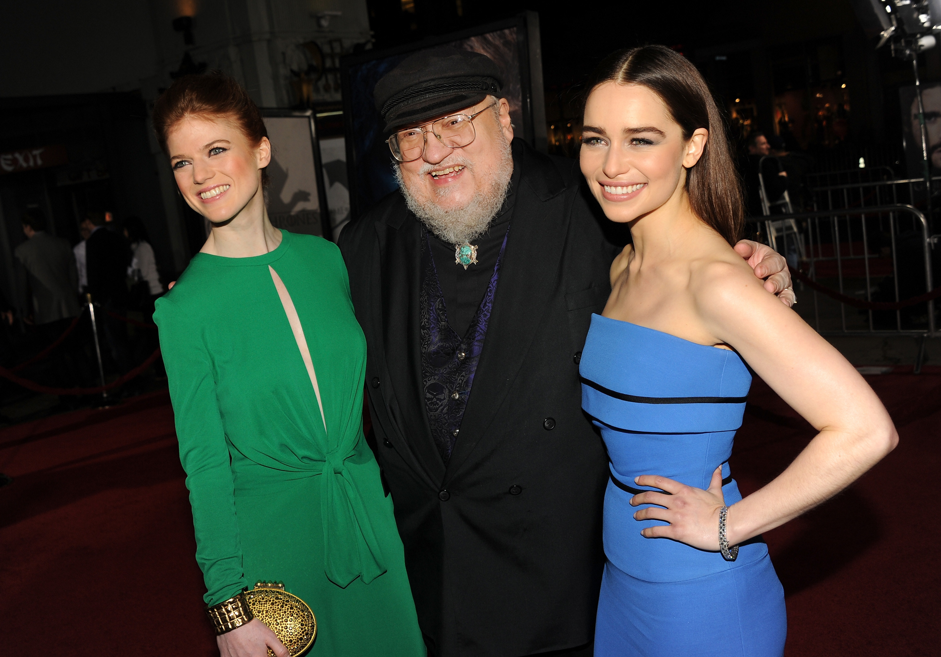 George stands with Game of Thrones actors Rose Leslie and Emilia Clarke