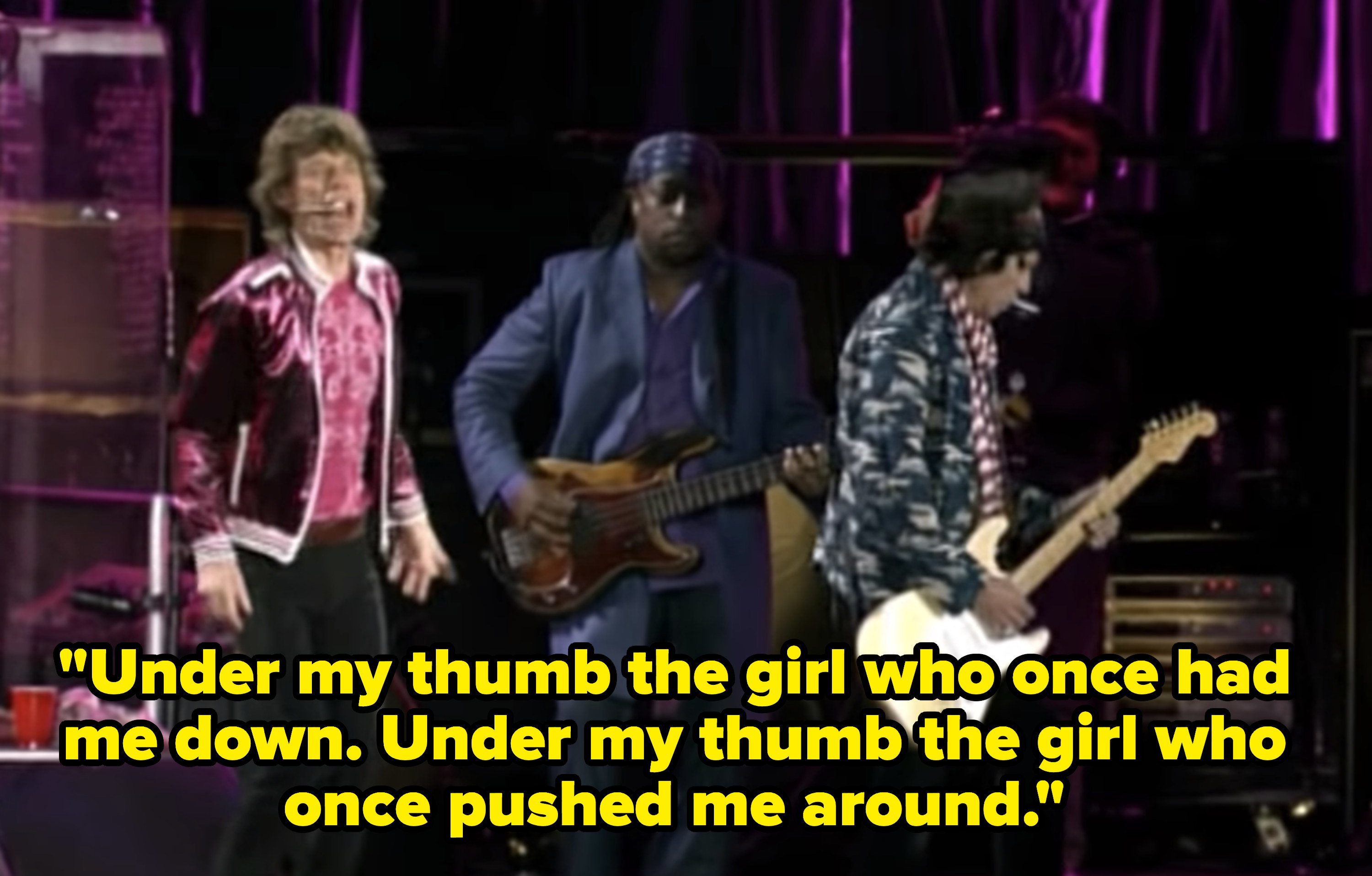 """Mick Jagger singing lyrics """"Under my thumb the girl who once had me down. Under my thumb the girl who once pushed me around"""""""