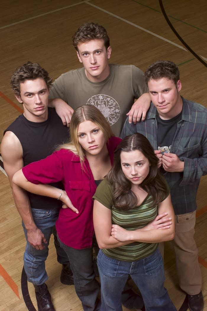 Philipps, James Franco, Linda Cardellini, Seth Rogen, and Jason Segel pose for a promotional photo on a hardwood basketball court