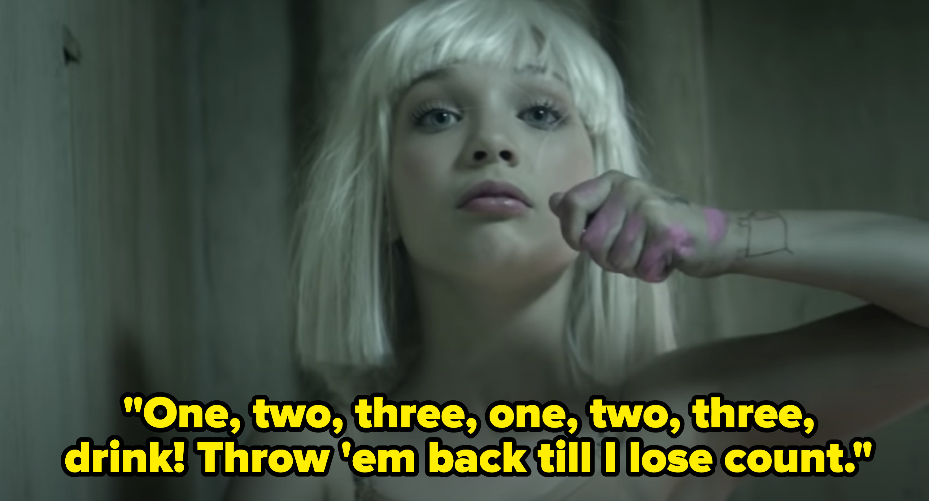 """Maddie Ziegler dancing in the """"Chandelier"""" music video with the lyrics,""""One, two, three, one, two, three, drink! Throw 'em back till I lose count"""""""
