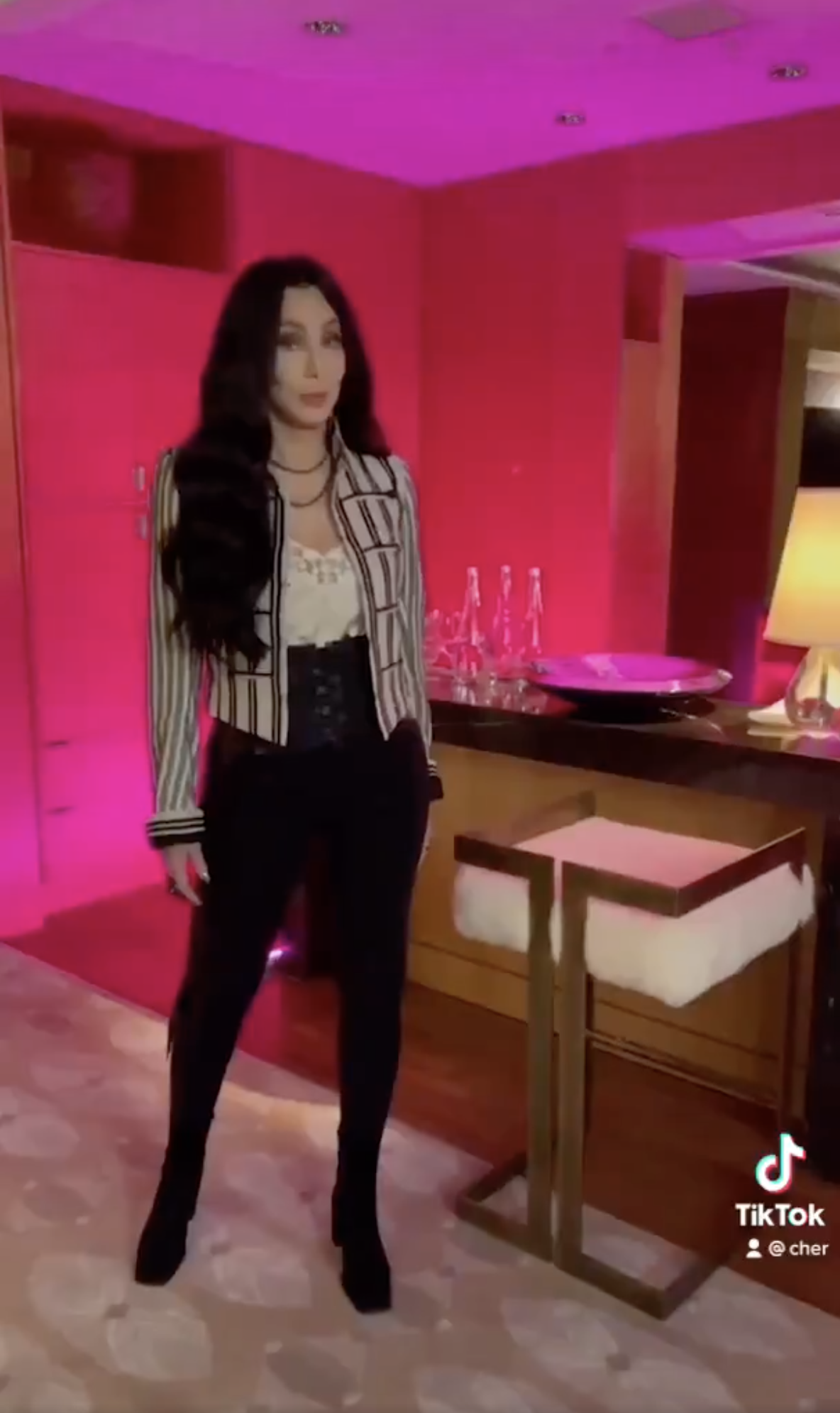 Cher appears as a brunette in her first TikTok video