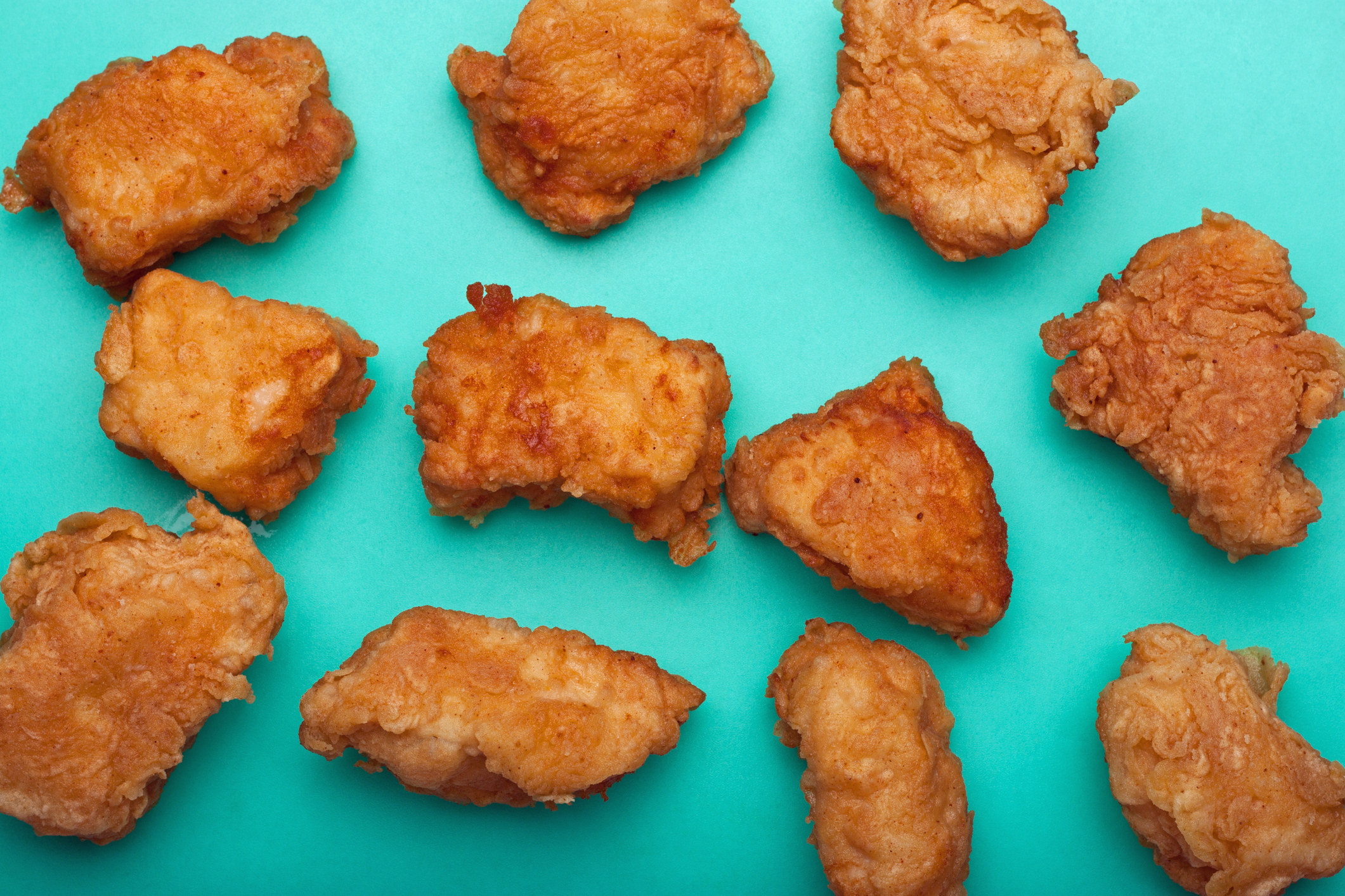 A bunch of wings artfully spread out on a surface