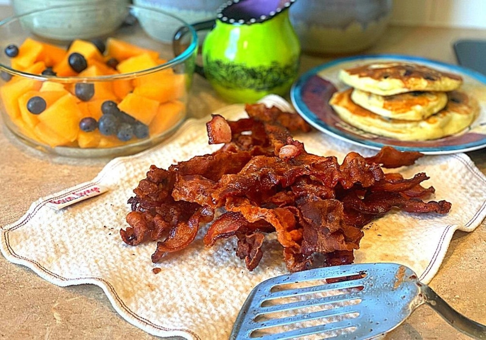 Pile of bacon sitting on the quilted cloth