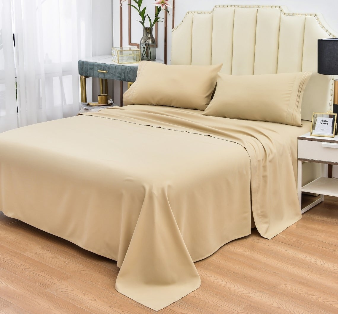Tan bedsheets on bed