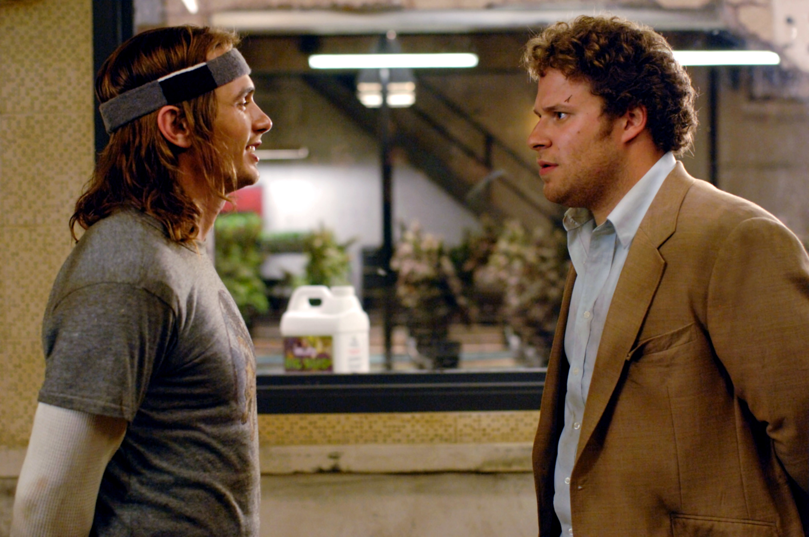 James Franco, in a shirt and headband, and Seth Rogen, in a jacket and blue collared shirt, in Pineapple Express