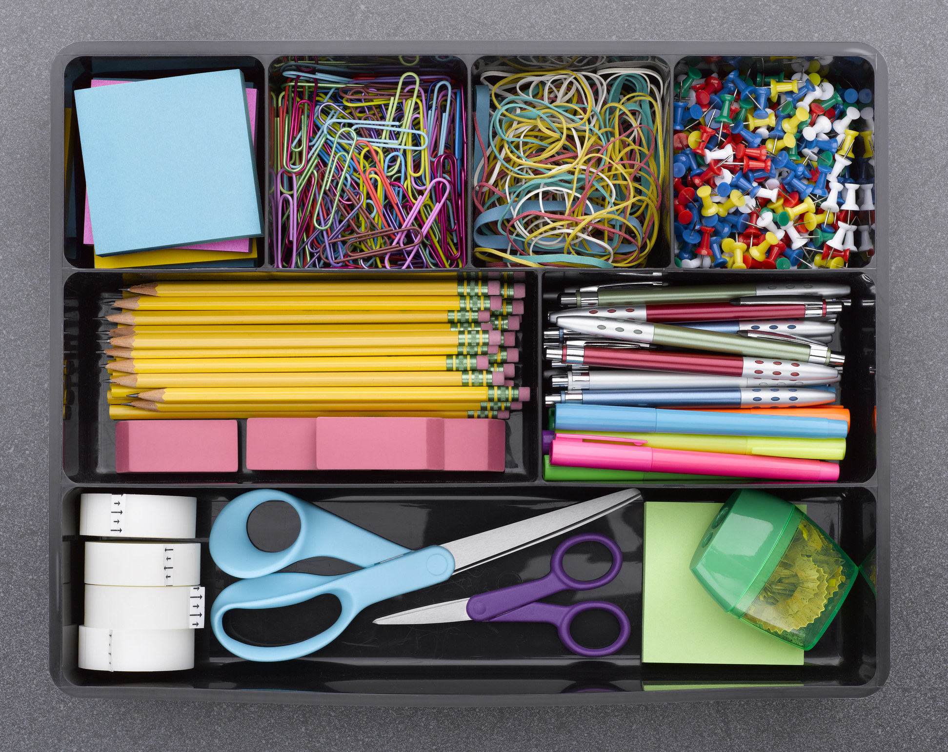 Very organized office supplies in different sections
