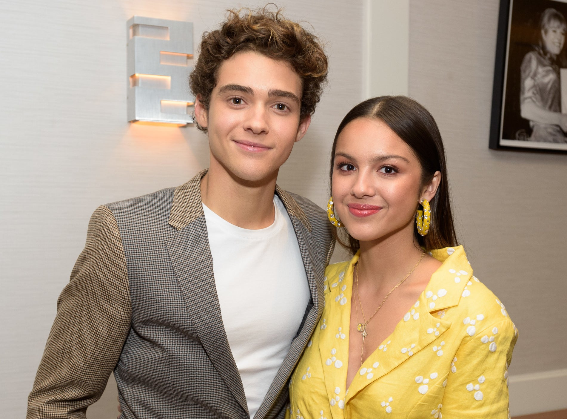 Joshua and Olivia pose together at an event