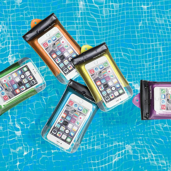 Several phones floating in a pool while safe inside the waterproof cases