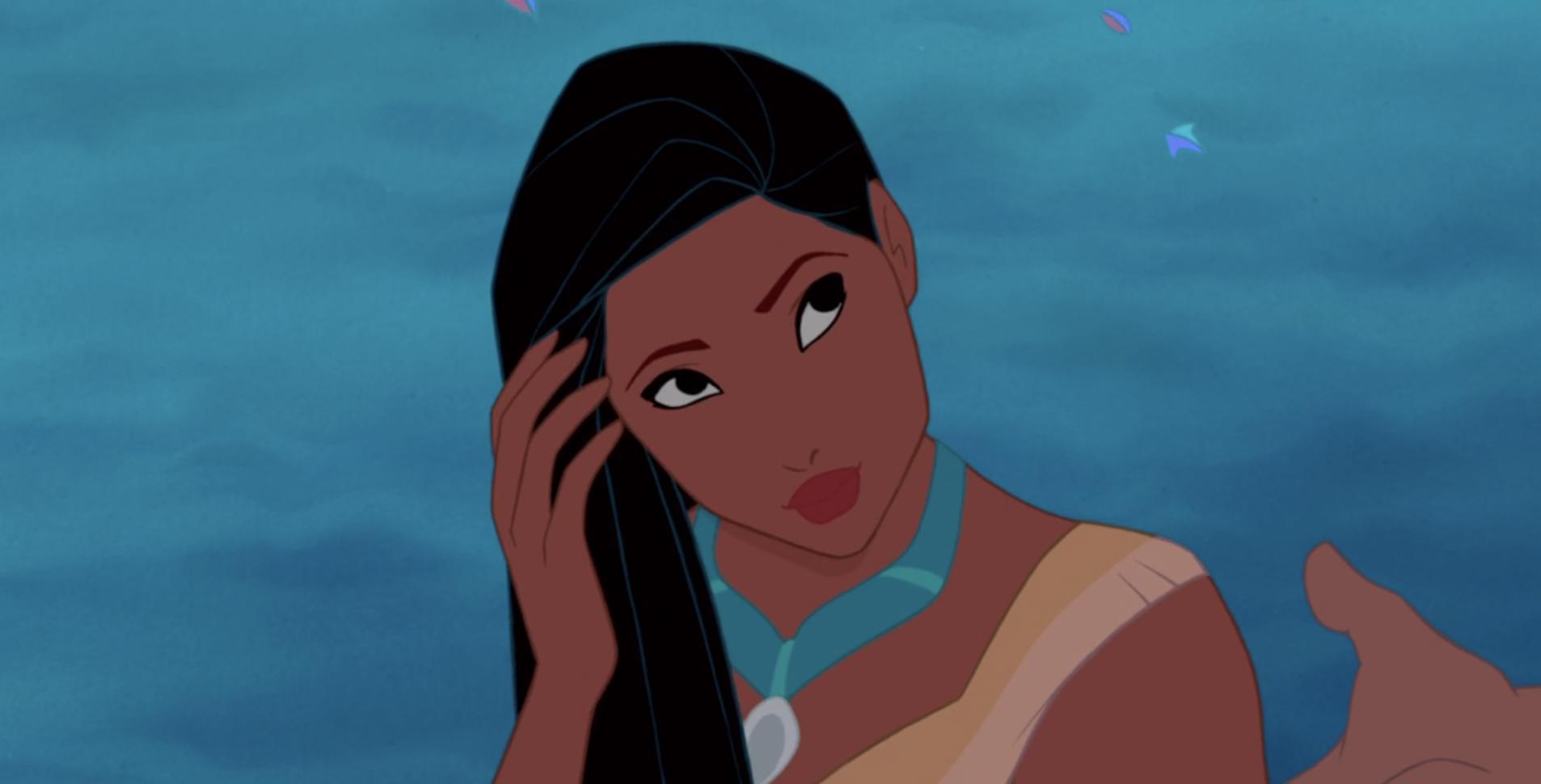 Pocahontas tucks some hair behind her ear
