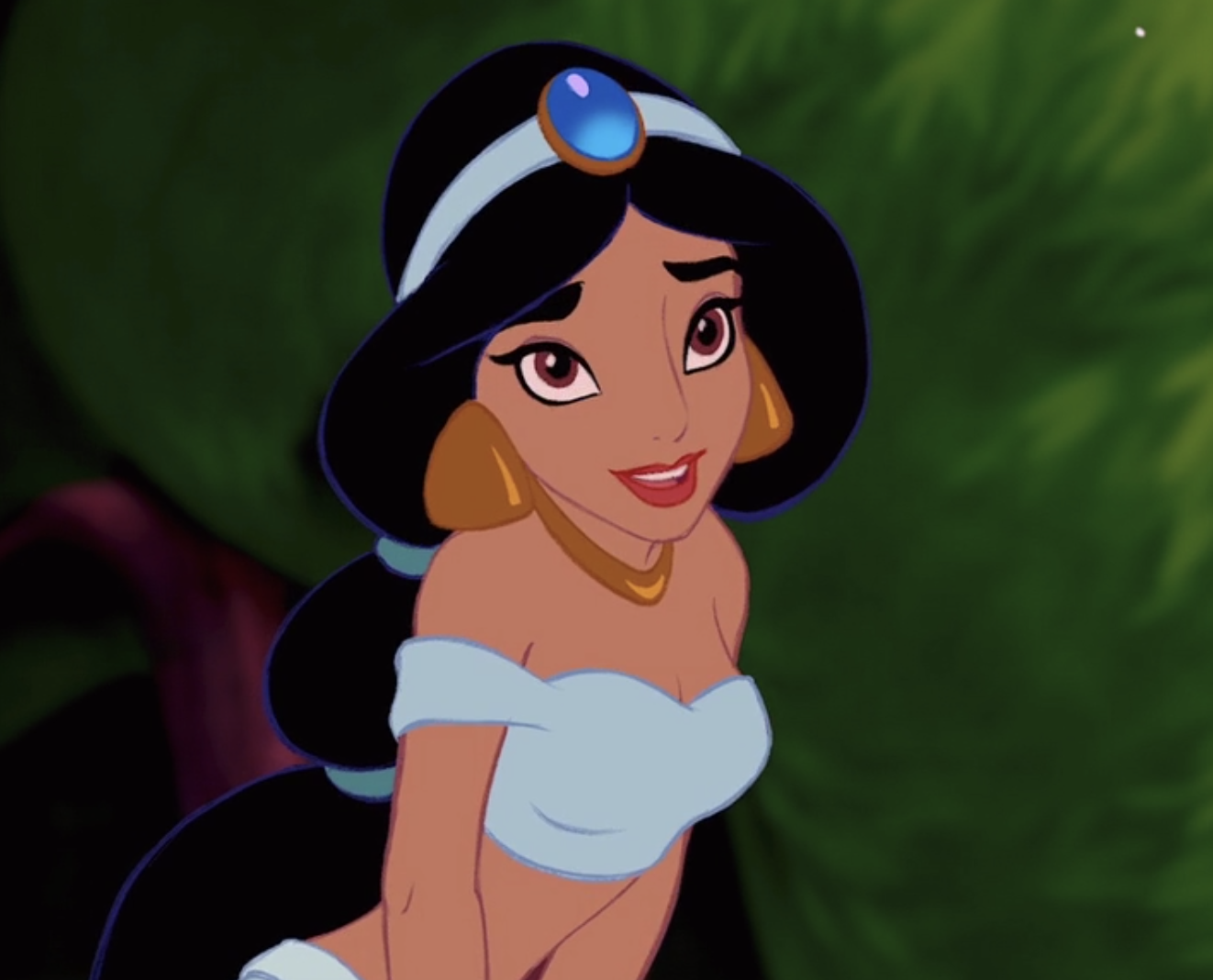 Jasmine sits on the edge of a fountain and smiles