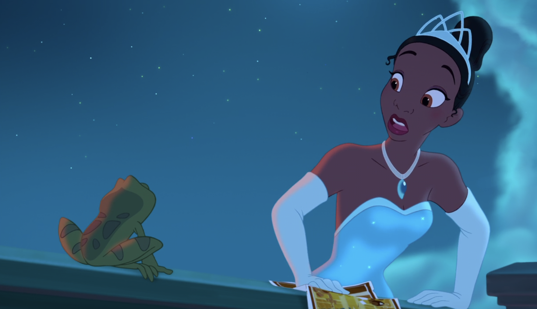 Tiana opens her eyes wide in surprise as she looks down at Naveen the frog