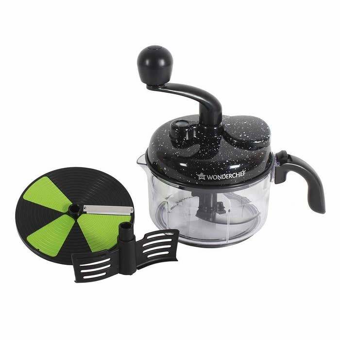 The manual food processor pictured with its slicing and chopping blades and kneading attachment