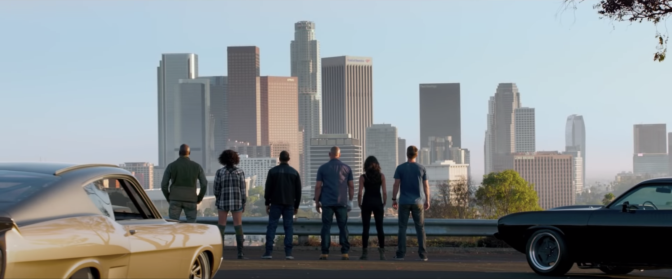 The crew looking at the city skyline