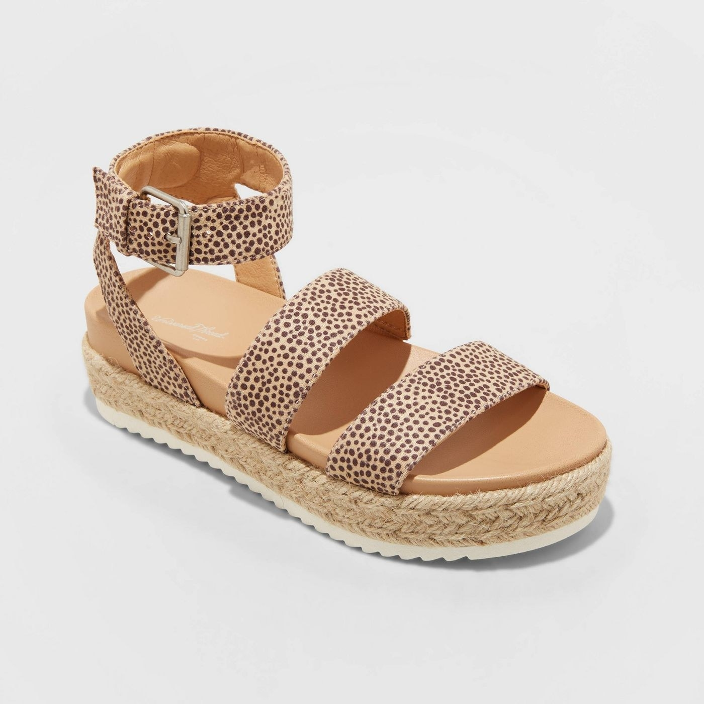 sandals with a roped braided bottom and leopard straps
