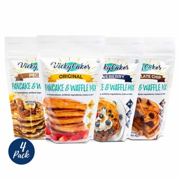 Four pouches of different-flavored pancake mixes