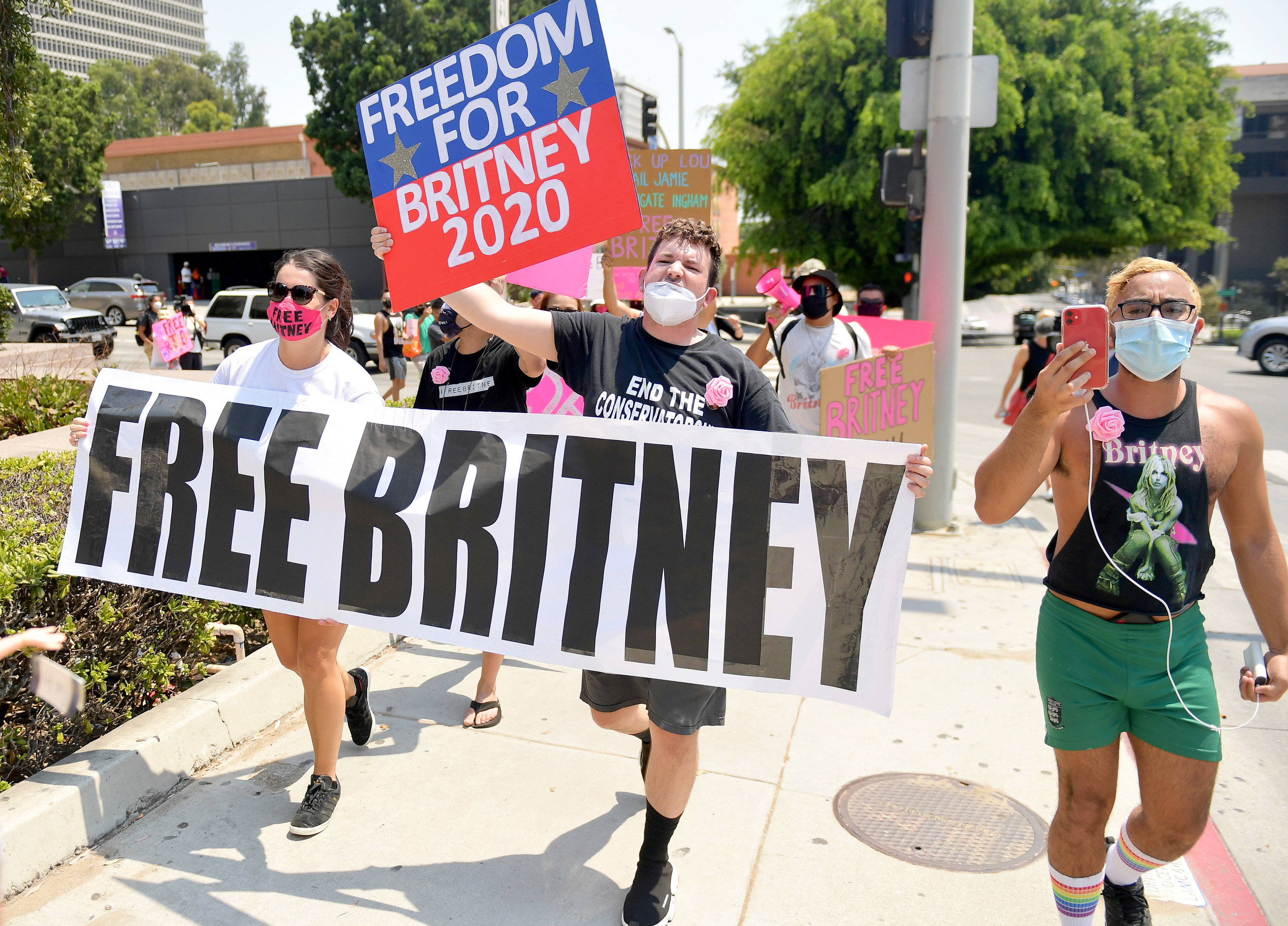 """Britney Spears supporters carry signs that read """"Free Britney"""""""