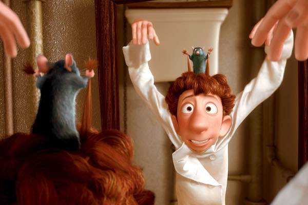 Remy plays the puppetmaster by pulling Linguini's hair.