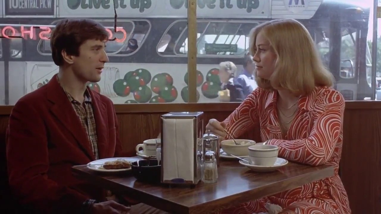 """Travis and Iris sitting down for a meal in """"Taxi Driver"""""""