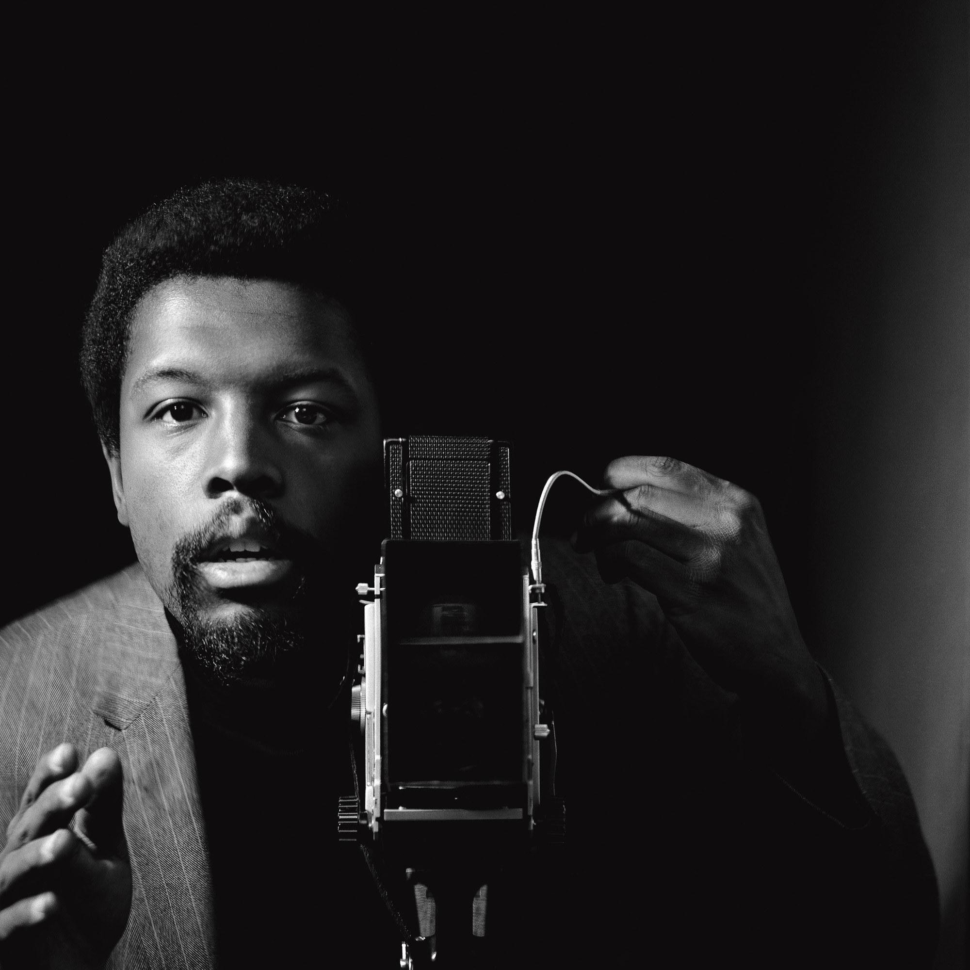 A black-and-white self-portrait of the photographer Kwame Brathwaite, circa 1964, taken in Harlem