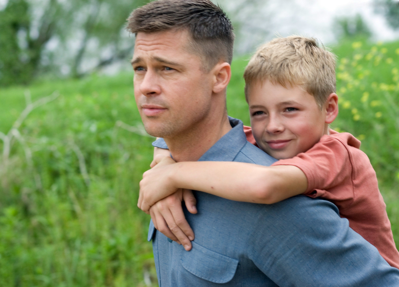 Brad Pitt's character holding his son