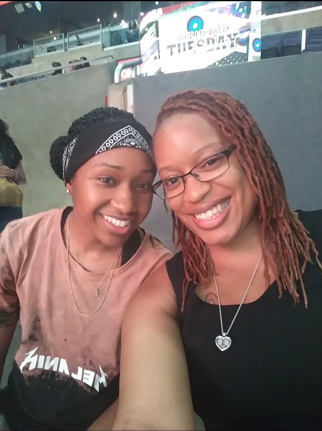Precious and her wife taking a selfie at a stadium