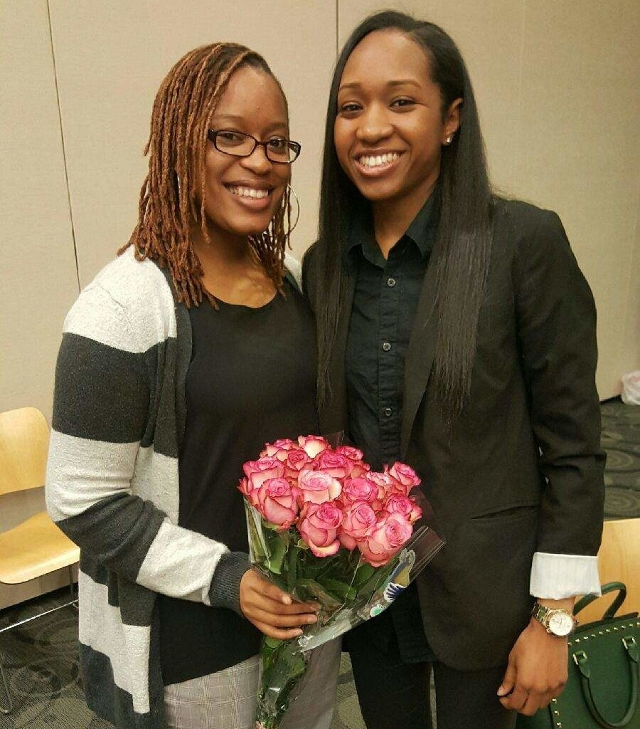 Precious and her wife holding flowers