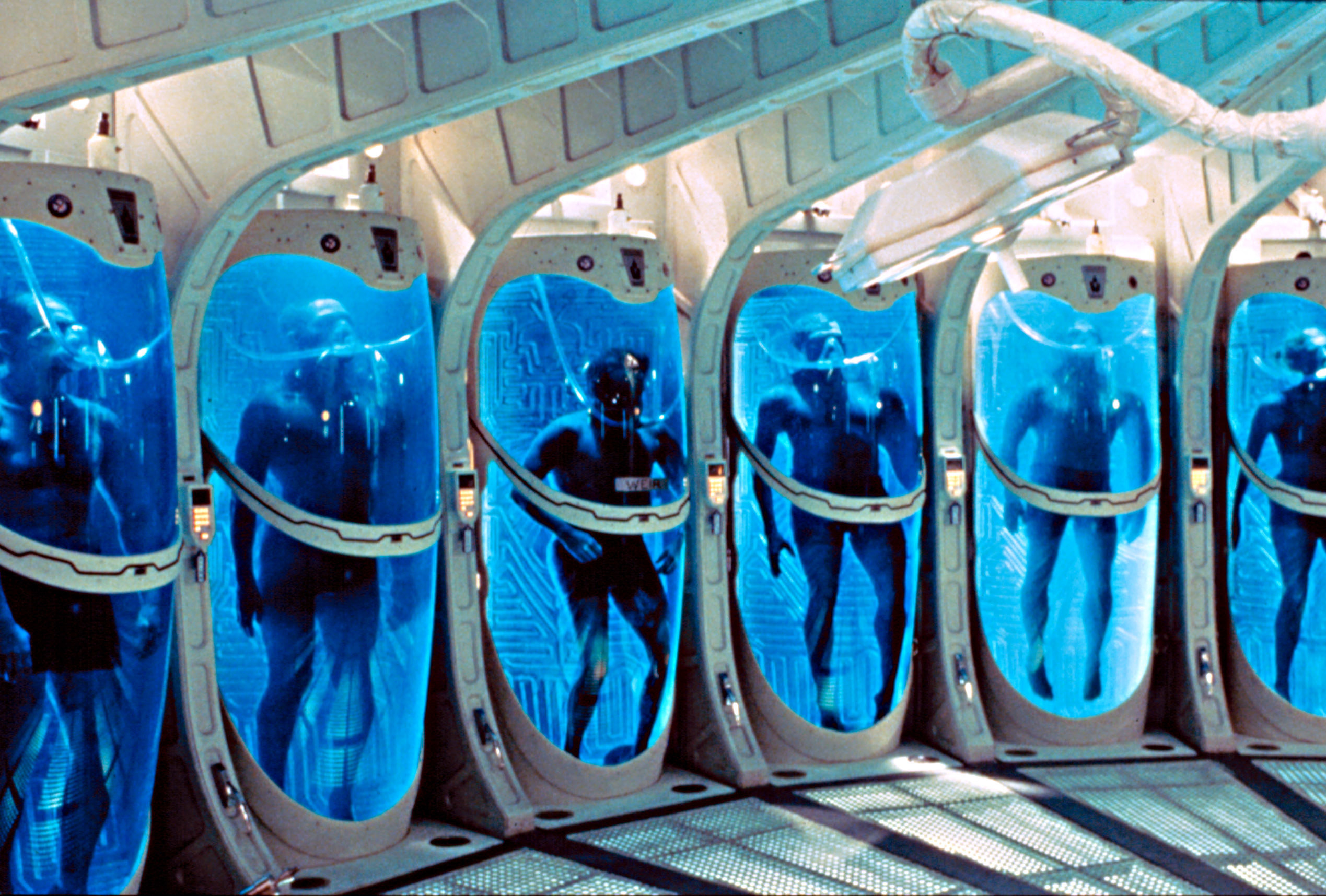 astronauts in sleep chambers