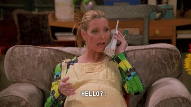 Phoebe looking incredulous as she speaks on an old phone