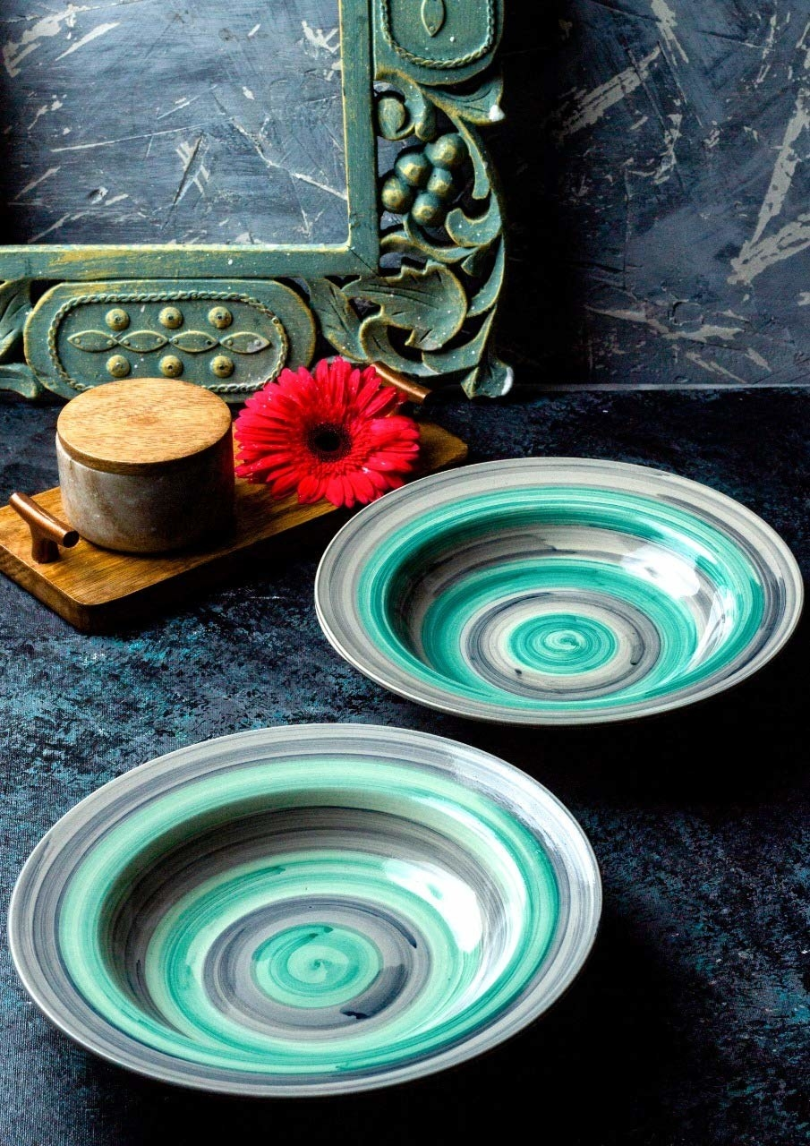 A pair of teal pasta plates.