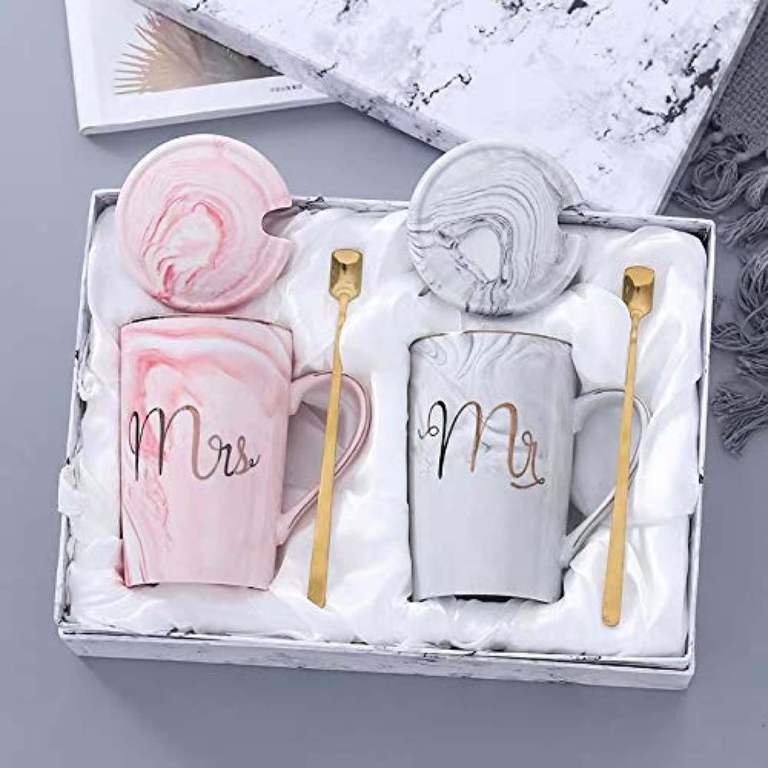 A set of pastel pink and grey Mrs. & Mr. Coffee mugs.