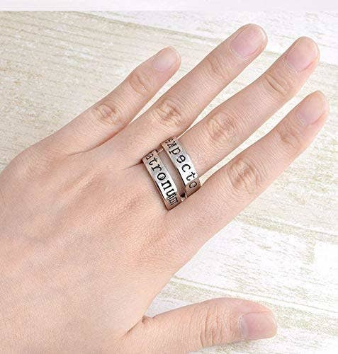 A hand wearing a twisted Expecto Patronum ring.