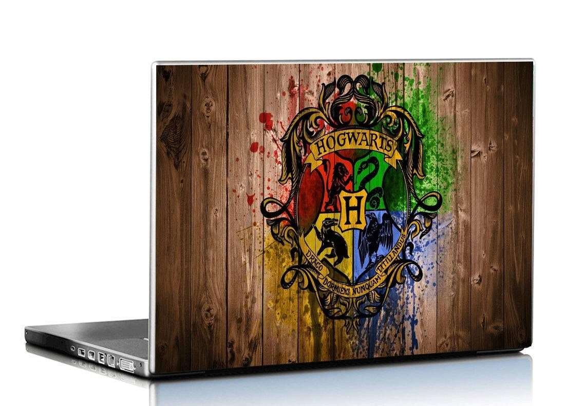 A laptop with a Hogwarts crest skin on it.